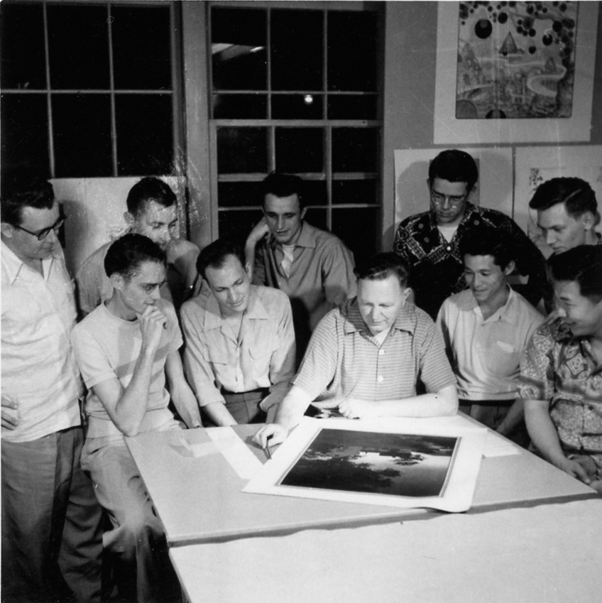 Bruce Goff confers with students in the early 1950s in Building 604 on the North Base